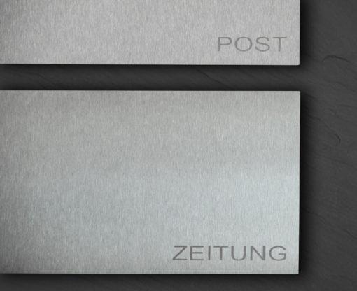 Detailansicht Briefkasten und Zeitungsbox in Edelstahl mit Beschriftung